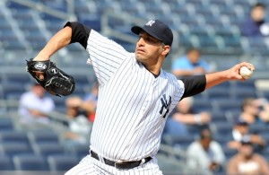 Pettitte works into the eighth inning for his third win. (Source: Jason Szenes/Getty)
