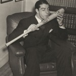 Taken in December 1941, Joe DiMaggio kisses his bat after the season in which he hit in 56 consecutive games.