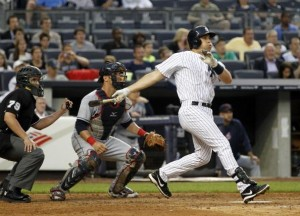 Mark Teixeira had the big bat, a grand slam, in tonight's win. (Photo by Jason Szenes/Getty Images