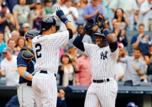 Derek Jeter and Alfonso Soriano celebrate a home run in today's win. (Photo by Jim McIsaac/Getty Images)