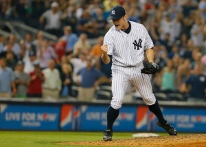 David Robertson pumps his fist after his first save of the 2013 season. (Photo by Mike Stobe/Getty Images)