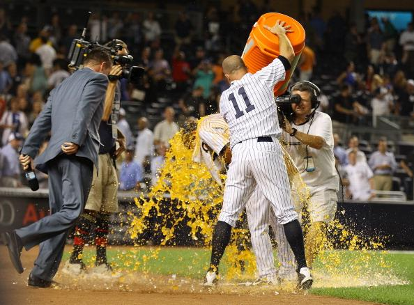 Brett Gardner does the Gatorade honors for walk-off winner Jayson Nix in tonight's win. (Photo by Mike Stobe/Getty Images)