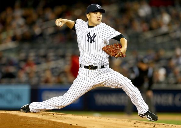 Masahiro Tanaka's absence in the second half may cost the Yankees a post season spot. (Photo by Elsa/Getty Images)