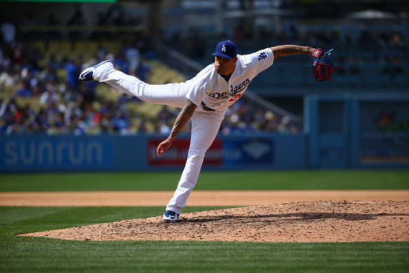 LOS ANGELES, CA - MAY 24:  Pitcher Sergio Santos #26 of the Los Angeles Dodgers pitches in the ninth inning during the MLB game against the San Diego Padres at Dodger Stadium on May 24, 2015 in Los Angeles, California. The Padres defeated the Dodgers 11-3.  (Photo by Victor Decolongon/Getty Images)