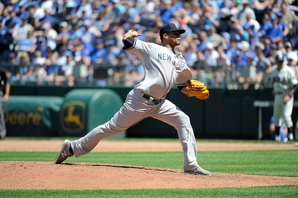 KANSAS CITY, MO - MAY 17:  Esmil Rogers #53 of the New York Yankees throws against the Kansas City Royals at Kauffman Stadium on May 17, 2015 in Kansas City, Missouri. (Photo by Ed Zurga/Getty Images)