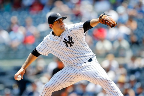 NEW YORK, NY - JUNE 10:  Nathan Eovaldi #30 of the New York Yankees pitches in the first inning against the Washington Nationals at Yankee Stadium on June 10, 2015 in the Bronx borough of New York City.  (Photo by Jim McIsaac/Getty Images)