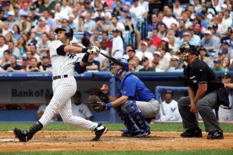 NEW YORK - JUNE 18: Derek Jeter #2 of the New York Yankees hits his first grand slam home run at the bottom of the sixth against Joe Borowski #48 of the Chicago Cubs on June 18, 2005 at Yankee Stadium in the Bronx borough of New York City. (Photo by Nick Laham/Getty Images)