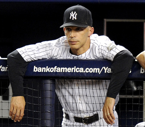 Manager Joe Girardi has what looks like a black eyes after the Yankees and Blue Jays fight after Jorge Posada hit Blue Jays pitcher Jesse Carlson after crossing home  in the 8th  inning. New York Yankees against the Toronto Blue Jays at Yankee Stadium. YROPE16S