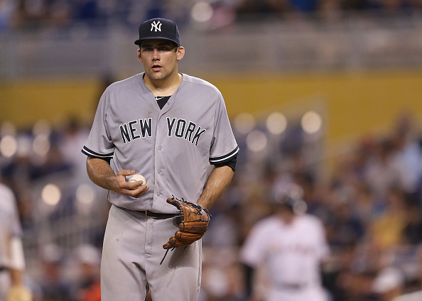 MIAMI, FL - JUNE 16:  Nathan Eovaldi #30 of the New York Yankees reacts during the first inning of the game against the Miami Marlins at Marlins Park on June 16, 2015 in Miami, Florida.  (Photo by Rob Foldy/Getty Images)
