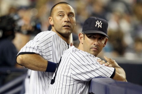 NEW YORK, NY - SEPTEMBER 20:  Derek Jeter #2 and Jorge Posada #20 of the New York Yankees in action against the Tampa Bay Rays on September 20, 2011 at Yankee Stadium in the Bronx borough of New York City. The Yankees defeated the Rays 5-0.  (Photo by Jim McIsaac/Getty Images)