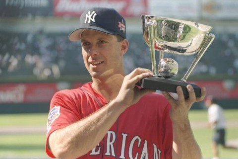 7 Jul 1997:  First baseman Tino Martinez of the New York Yankees holds his trophy during the MLB Allstar Game Home Run Derby at Jacobs Field in Cleveland, Ohio. Martinez was winner. Mandatory Credit: Doug Pensinger  /Allsport