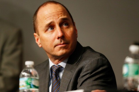 NEW YORK, NY - DECEMBER 20:  General Manager Brian Cashman looks on during Carlos Beltran's introductory press conference at Yankee Stadium on December 20, 2013 in the Bronx borough of New York City.  (Photo by Mike Stobe/Getty Images)