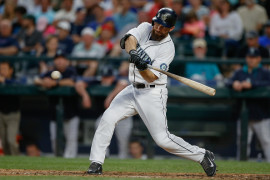SEATTLE, WA - JUNE 23:  Dustin Ackley #13 of the Seattle Mariners flies out to center in the seventh inning against the Kansas City Royals at Safeco Field on June 23, 2015 in Seattle, Washington.  (Photo by Otto Greule Jr/Getty Images)
