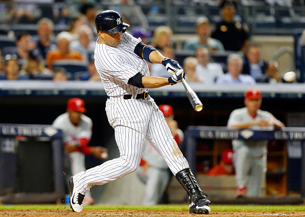 NEW YORK, NY - JUNE 22:  Carlos Beltran #36 of the New York Yankees connects on a fifth inning double against the Philadelphia Phillies at Yankee Stadium on June 22, 2015 in the Bronx borough of New York City. The Phillies defeated the Yankees 11-8.  (Photo by Jim McIsaac/Getty Images)