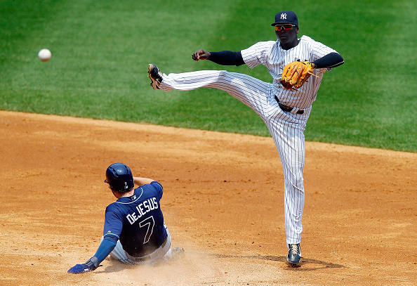 NEW YORK, NY - JULY 05:  Didi Gregorius #18 of the New York Yankees completes a third inning ending double play after forcing out David DeJesus #7 of the Tampa Bay Rays at Yankee Stadium on July 5, 2015 in the Bronx borough of New York City.  (Photo by Jim McIsaac/Getty Images)