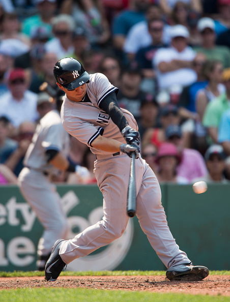 BOSTON, MA - JULY 12:  Rob Refsnyder #64 of the New York Yankees hits a single during the seventh inning against the Boston Red Sox at Fenway Park in Boston, Massachusetts on July 12, 2015. It was the first career hit for Refsnyder. (Photo by Michael Ivins/Boston Red Sox/Getty Images)
