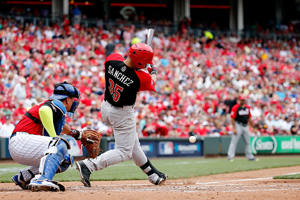 CINCINNATI, OH - JULY 12:  Gary Sanchez #35 of the World Team bats against the U.S. Team during the SiriusXM All-Star Futures Game at the Great American Ball Park on July 12, 2015 in Cincinnati, Ohio.  (Photo by Rob Carr/Getty Images)