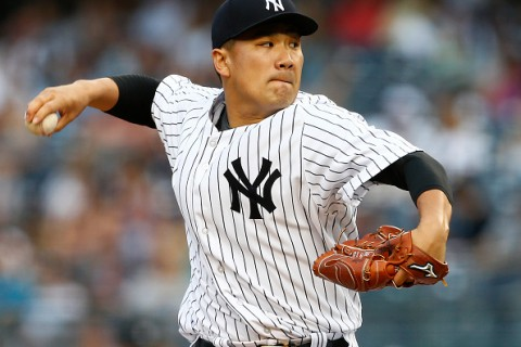 NEW YORK, NY - JULY 17: Pitcher Masahiro Tanaka #19 of the New York Yankees delivers a pitch against the Seattle Mariners during the first inning of a MLB baseball game at Yankee Stadium on July 17, 2015 in the Bronx borough of New York City. (Photo by Rich Schultz/Getty Images)