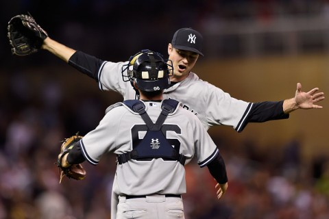 MINNEAPOLIS, MN - JULY 25: Andrew Miller #48 and John Ryan Murphy of the New York Yankees celebrate a win of the game against the Minnesota Twins on July 25, 2015 at Target Field in Minneapolis, Minnesota. The Yankees defeated the Twins 8-5. (Photo by Hannah Foslien/Getty Images)
