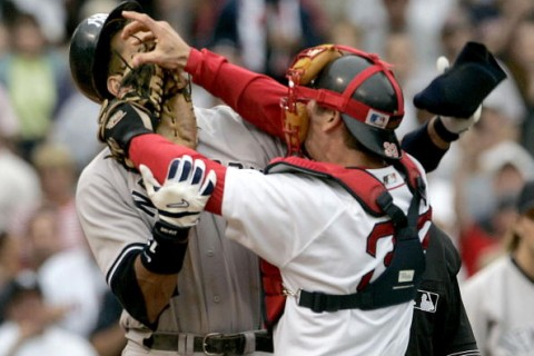 Boston Red Sox catcher Jason Varitek, right, strikes New York Yankees batter Alex Rodriguez at Fenway Park in Boston. The two fought after Rodriguez was hit by a pitch by Red Sox pitcher Bronson Arroyo. The Red Sox won, 11-10,  with a 9th-inning game winning home run by Bill Mueller.  (Photo by J Rogash/WireImage)