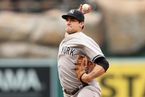 ANAHEIM, CA - JULY 01:  Nathan Eovaldi #30 of the New York Yankees throws a pitch aganst the Los Angeles Angels of Anaheim at Angel Stadium of Anaheim on July 1, 2015 in Anaheim, California.  (Photo by Stephen Dunn/Getty Images)