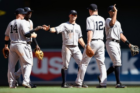 MINNEAPOLIS, MN - JULY 26: (L-R) Stephen Drew #14, Didi Gregorius #18, Brett Gardner #11, Chase Headley #12 and Chris Young #24 of the New York Yankees celebrate a win of the game against the Minnesota Twins on July 26, 2015 at Target Field in Minneapolis, Minnesota. The Yankees defeated the Twins 7-2. (Photo by Hannah Foslien/Getty Images)