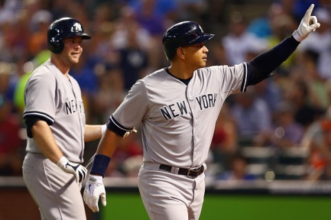 ARLINGTON, TX - JULY 27:  Alex Rodriguez #13 of the New York Yankees celebrates with Brian McCann #34 of the New York Yankees after hitting a solo home run against the Texas Rangers in the top of the sixth inning at Globe Life Park in Arlington on July 27, 2015 in Arlington, Texas.  (Photo by Tom Pennington/Getty Images)