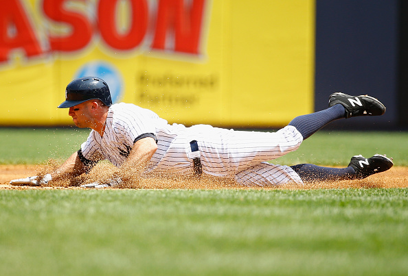 NEW YORK, NY - MAY 27:  Brett Gardner #11 of the New York Yankees slides into second base with a double against the Kansas City Royals during their game at Yankee Stadium on May 27, 2015 in New York City.  (Photo by Al Bello/Getty Images)