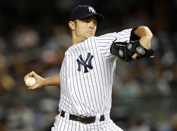 NEW YORK, NY - SEPTEMBER 03: David Robertson #30 of the New York Yankees in action against the Boston Red Sox during a MLB baseball game at Yankee Stadium on September 3, 2014 in the Bronx borough of New York City. (Photo by Rich Schultz/Getty Images)