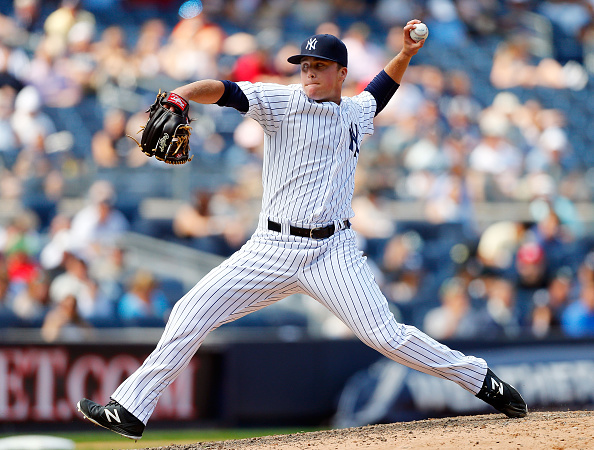NEW YORK, NY - JUNE 10:  Jacob Lindgren #64 of the New York Yankees in action against the Washington Nationals at Yankee Stadium on June 10, 2015 in the Bronx borough of New York City. The Nationals defeated the Yankees 5-4 in 11 innings.  (Photo by Jim McIsaac/Getty Images)