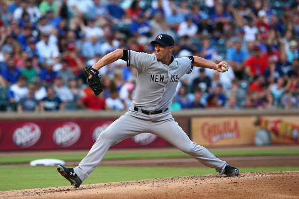 ARLINGTON, TX - JULY 28:  Chris Capuano #26 of the New York Yankees throws in the first inning against the Texas Rangers at Globe Life Park in Arlington on July 28, 2015 in Arlington, Texas.  (Photo by Ronald Martinez/Getty Images)
