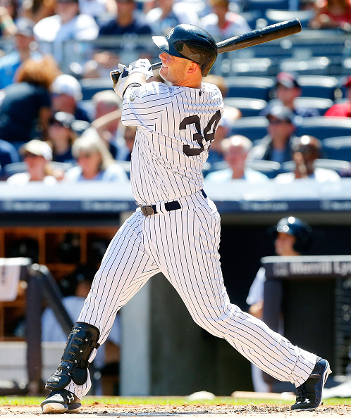 NEW YORK, NY - AUGUST 22:  Brian McCann #34 of the New York Yankees follows through on a first inning home run against the Cleveland Indians at Yankee Stadium on August 22, 2015 in the Bronx borough of New York City.  (Photo by Jim McIsaac/Getty Images)