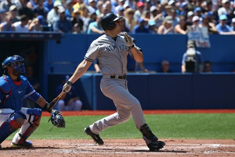 TORONTO, CANADA - AUGUST 15: Mark Teixeira #25 of the New York Yankees pops out in the third inning during MLB game action against the Toronto Blue Jays on August 15, 2015 at Rogers Centre in Toronto, Ontario, Canada. (Photo by Tom Szczerbowski/Getty Images)