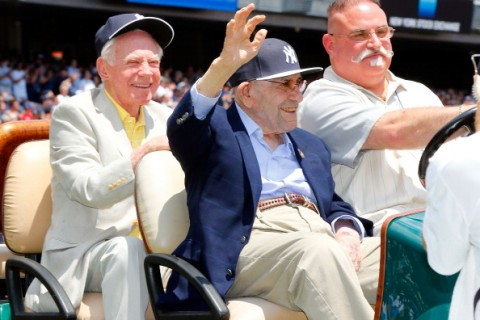 NEW YORK, NY - JUNE 22:  Former New York Yankees Whitey Ford (L) and Yogi Berra are introduced during the teams Old Timers Day prior to a game between the New York Yankees and the Baltimore Orioles at Yankee Stadium on June 22, 2014 in the Bronx borough of New York City.  The Orioles defeated the Yankees 8-0.  (Photo by Jim McIsaac/Getty Images)