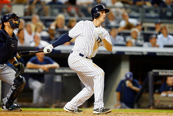 NEW YORK, NY - SEPTEMBER 04:  Greg Bird #31 of the New York Yankees follows through on a seventh inning two run home run against the Tampa Bay Rays at Yankee Stadium on September 4, 2015 in the Bronx borough of New York City.  (Photo by Jim McIsaac/Getty Images)