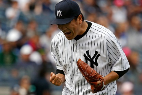 NEW YORK, NY - SEPTEMBER 13: Masahiro Tanaka #19 of the New York Yankees reacts after the final out in the seventh inning against the Toronto Blue Jays at Yankee Stadium on September 13, 2015 in the Bronx borough of New York City. (Photo by Adam Hunger/Getty Images)