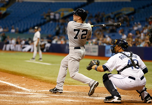 ST. PETERSBURG, FL - SEPTEMBER 14:  Slade Heathcott #72 of the New York Yankees hits a three-run home run in front of catcher J.P. Arencibia #40 of the Tampa Bay Rays during the ninth inning of a game on September 14, 2015 at Tropicana Field in St. Petersburg, Florida.  (Photo by Brian Blanco/Getty Images)