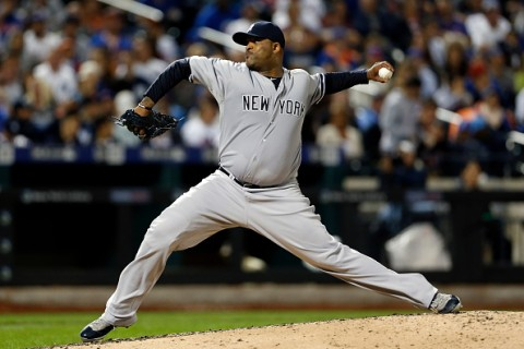 NEW YORK, NY - SEPTEMBER 20: CC Sabathia #52 of the New York Yankees pitches during the third inning against the New York Mets at Citi Field on September 20, 2015 in the Queens borough of New York City. (Photo by Adam Hunger/Getty Images)