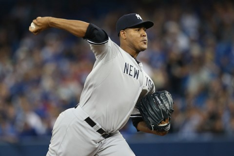 TORONTO, CANADA - SEPTEMBER 23: Ivan Nova #47 of the New York Yankees delivers a pitch in the first inning during MLB game action against the Toronto Blue Jays on September 23, 2015 at Rogers Centre in Toronto, Ontario, Canada. (Photo by Tom Szczerbowski/Getty Images)