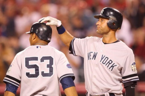 ANAHEIM, CA - SEPTEMBER 09:   (L-R)Bobby Abreu #53 and teammate Derek Jeter #2 of the New York Yankees celebrate scoring in the sixth inning against the Los Angeles Angels of Anaheim at Angels Stadium on September 9, 2008 in Anaheim, California.  (Photo by Lisa Blumenfeld/Getty Images)