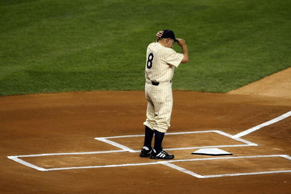 NEW YORK - SEPTEMBER 21:  Yogi Berra stands on the field during a pregame ceremony prior to the start of the last regular season game at Yankee Stadium between the Baltimore Orioles and the New York Yankees on September 21, 2008 in the Bronx borough of New York City. The Yankees are playing their final season in the 85 year old ball park and plan on moving into the new Yankee Stadium across the street to start the 09 season.  (Photo by Nick Laham/Getty Images)