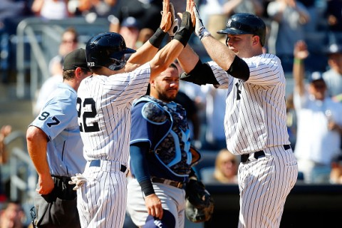 NEW YORK, NY - SEPTEMBER 06:  Brian McCann #34 of the New York Yankees celebrates his game tying sixth inning three run home run with teammate Jacoby Ellsbury #22 as Rene Rivera #44 of the Tampa Bay Rays looks on at Yankee Stadium on September 6, 2015 in the Bronx borough of New York City.  (Photo by Jim McIsaac/Getty Images)
