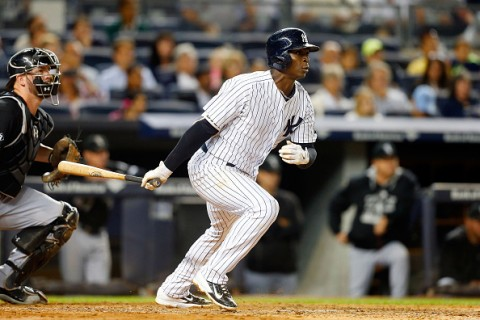 NEW YORK, NY - SEPTEMBER 25:  Didi Gregorius #18 of the New York Yankees follows through on a fourth inning two run base hit against the Chicago White Sox at Yankee Stadium on September 25, 2015 in the Bronx borough of New York City.  (Photo by Jim McIsaac/Getty Images)