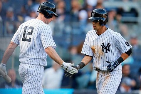 NEW YORK, NY - SEPTEMBER 27:  Rico Noel #70 of the New York Yankees celebrates after scoring on Greg Bird #31 of the New York Yankees single in the eighth inning at Yankee Stadium on September 27, 2015 in the Bronx borough of New York City.  (Photo by Mike Stobe/Getty Images)