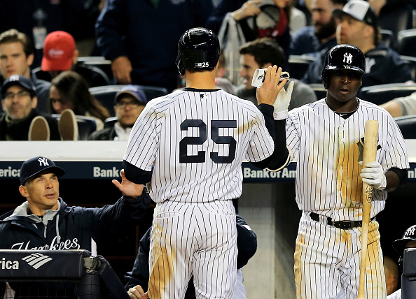 NEW YORK, NY - APRIL 12:  Mark Teixeira #25 of the New York Yankees is congratulated by teammate Didi Gregorius #18 after Teixeira scored in the sixth inning against the Boston Red Sox on April 12, 2015 at Yankee Stadium in the Bronx borough of New York City.  (Photo by Elsa/Getty Images)