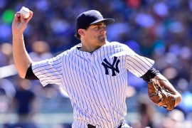 NEW YORK, NY - SEPTEMBER 05:  Nathan Eovaldi #30 of the New York Yankees delivers a pitch against the Tampa Bay Rays at Yankee Stadium on September 5, 2015 in New York City. The Tampa Bay Rays defeatd the New York Yankees 3-2. (Photo by Steven Ryan/Getty Images)