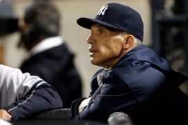 NEW YORK, NY - SEPTEMBER 20:  Manager Joe Girardi #28 of the New York Yankees looks on from the dugout against the New York Mets at Citi Field on September 20, 2015 in the Queens borough of New York City. (Photo by Adam Hunger/Getty Images)