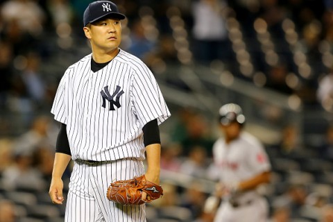 NEW YORK, NY - SEPTEMBER 30:  Masahiro Tanaka #19 of the New York Yankees reacts after giving up a three run home run to Travis Shaw of the Boston Red Sox in the first inning on September 30, 2015 at Yankee Stadium in the Bronx borough of New York City.  (Photo by Elsa/Getty Images)