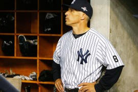 NEW YORK, NY - OCTOBER 06:  (NEW YORK DAILIES OUT)   Manager Joe Girardi #28 of the New York Yankees looks on before the American League Wild Card Game against the Houston Astros at Yankee Stadium on October 6, 2015 in the Bronx borough of New York City, New York. The Astros defeated the Yankees 3-0.  (Photo by Jim McIsaac/Getty Images)