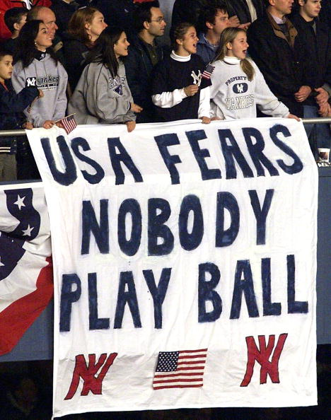 NEW YORK, UNITED STATES:  A banner hangs in front of baseball fans during Game 3 of the World Series in New York's Yankee Stadium 30 October, 2001. The Arizona Diamondbacks lead the New York Yankees 2-0 in the series. AFP PHOTO/Don EMMERT (Photo credit should read DON EMMERT/AFP/Getty Images)